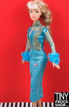 This blue sparkle dress is super cute!!! Barbie looks like she is entering the space race in this foil covered slim dress with sequins and beads. Paired with see thru plastic jacket with blue fur and