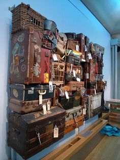 Love this vintage suitcase wall. What a story it could tell. I wish I could read the old tags and stickers to see where they have been! Old Trunks, Vintage Trunks, Trunks And Chests, Vintage Suitcases, Vintage Luggage, Vintage Travel, Old Luggage, Suitcase Storage, Displays