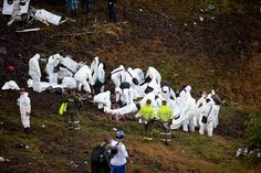 EDITORS NOTE: Graphic content / Members of the forensics team recover the bodies of victims of the LAMIA airlines charter plane crash in the mountains of Cerro Gordo, municipality of La Union, on November 29, 2016. A charter plane carrying the Chapecoense Real football team crashed in the mountains in Colombia late Monday, killing as many as 75 people, officials said. / AFP PHOTO / RAUL ARBOLEDARAUL ARBOLEDA/AFP/Getty Images