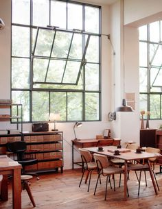 Open dining room with huge industrial windows