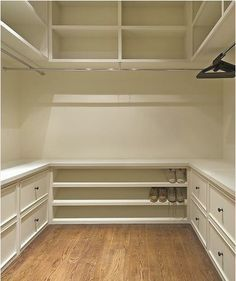 Nice Walk in Closet Organizer. Love the idea of that storage at the bottom