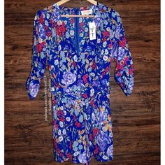 YUMI KIM Romper Liz Floral Printed V Neck Jumpsuit Available Sizes: Small and Medium.  New with tags.  $229 Retail + Tax.  Gorgeous floral printed romper featuring a tie belt at waist and crossover v neck. 2 side pockets. 3/4 length sleeves. Hidden back zip. Shorts are lined.  Polyester. Imported.   ❗️ No trades or holds.   Bundle 2+ items for a 20% discount!    Stop by my closet for even more items from this brand!  ✔️ Items are priced to sell, however reasonable offers will be considered…