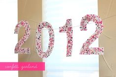 DIY confetti garland for New Year's  found at Warm Hot Chocolate