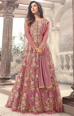 #Buy Tantalizing Raspberry #Pink Net #Floor_Length A-Line #Gown #Dress. This Ready To Stitch #Long #Embroidered Suit Set Has Featured With Scoop Neck And Full Sleeves. Diamond Work & Contrast Embroidery Are Adding Charm To It For Sangeet Party. #Designers#And#You #Maisha#DesignersDressesOnline #SonalChauhan