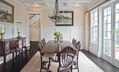 A traditional dining room with an antique chandelier. Bellevue, WA Coldwell Banker BAIN