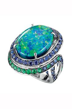 Ring Aiguebelle, set with an oval cabochon opal, paved in sapphires and emeralds in white gold from the La Dolce Riviera by Boucheron