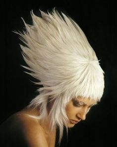 Avant garde extra voluminous hairstyle with bangs