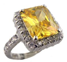 Description: Vintage style radiant cut 11x9mm 4.00 carat canary colored cubic zirconia ring accented with pave' set cubic zirconia framing the center stone in sterling silver and a rhodium plated finish....