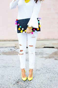 all white + pom pom tassel clutch