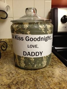 "Deployment countdown. Fill jar with number of Hershey kisses needed for each day deployed. Kid (or kids) each get a ""kiss goodnight"" from Daddy."