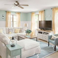 Blue and White Coastal Cottage living room before and after \/ Living room makeover