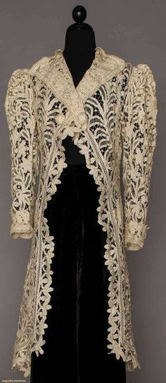 battenburg lace edwardian coat....Antique white, shawl collar, 2 buttons at bust, cut-away front, puff sleeves, knotted tassels at center back & above 2 side vents..1890-1920.