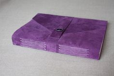 Handbound journal with purple suede cover and button closure by Katie Gonzalez of linenlaid&felt.