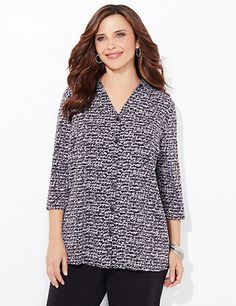 Reminiscent of handwritten notes, our beautiful buttonfront comes in a unique, allover text print. Complete with bust darts for a fitted feel. Three-quarter sleeves. Side slits at hem. Catherines tops are perfectly proportioned for the plus size woman. catherines.com