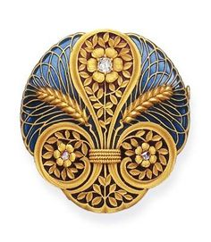 ANTIQUE VINTAGE ART NOUVEAU ENAMEL AND DIAMOND BROOCH Of Circular Outline, the Blue and Red Plique-à-Jour Enamel Plaque Set with Twin Wheat Sheaves and Scrolling Foliate Designs, Each Centering Upon a Rose or Old Mine-Cut Diamond Accent, Mounted in 18 K Gold, circa 1900.