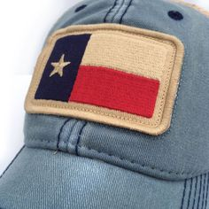 The Texas State flag trucker cap in a vintage, Americana Blue! Designed by our staff in New Bern.