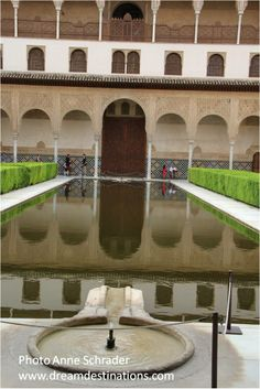 Fountain  in the Courtyard of Myrtles Nazaries Palace Alhambra Grenada Spain.  In the background is Comares Palace
