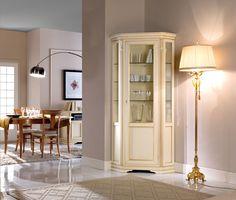 Vitrina pentru colt, colectia Marco Polo cu rafturi generoase pentru amintiri pretioase, ofera eleganta si intimitate casei dumneavoastra. Este infrumusetata cu un ornament sculptat manual, confectionata din lemn masiv. Disponibila in patru culori. Lungime: 69 cm; Latime: 28 cm; Inaltime: 215 cm #vitrine #mobilaliving #homedeco #homedecor #homedesign #mobilalemn #mobilaalba Decor, Living Room, Furniture, Room, Cabinet, Glass Cabinet, Corner Unit, Corner Unit Living Room, Home Decor
