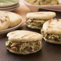 Arepas define Venezuelan cooking. These thick cornmeal patties are griddled, then baked, and then stuffed while warm with anything from…