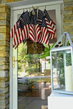 Easy DIY American Flag Display for the Front Door Add a bit of red, white and blue to your front door by creating this quick and easy DIY American flag display using a hanging basket and flags. Fourth Of July Decor, 4th Of July Celebration, 4th Of July Decorations, 4th Of July Party, 4th Of July Wreath, July 4th, Halloween Decorations, Front Door Decor, Wreaths For Front Door