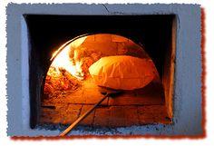 Irgoli, Cottura del pane Carasau    Baking typical Sardinia Bread in a wood oven