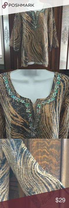 Beautiful Bell Sleeve Top By Exclusive Wear EPOC! Lite weight, fully lined, year around beautiful bell sleeve size M print top. Sequins and small beads around the neckline and extend down to approx. chest level. Small beads around the end of sleeves. Colors are cream, blue, gold and multi color sequins and beads. Exclusive Wear Tops