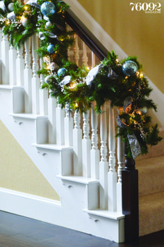Stairway decked with garland, 76092 Magazine, Holiday 2013 #holidaydecor #homedecor #christmasdecorations #garland
