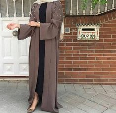 Fabric - Premium Nidha polyester, light weight and soft) Pop up buttons from neck to the knee Pearl detailing on the upper portion of the abaya and cuff of the sleeve NB: Hijab is not included Arab Fashion, Islamic Fashion, Muslim Fashion, Modest Fashion, Muslim Dress, Hijab Dress, Hijab Outfit, Hijab Chic, Abaya Style