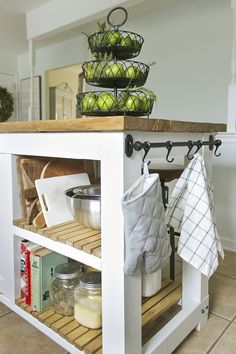 DIY Kitchen Island with shelves and built in trash compartment, downloadable plans. I am not big on the tilt out trash bin because full bags can be tough to get out, but a nice looking design.