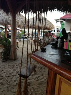A beach bar... With swings