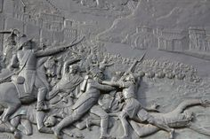 Bas-relief of Ponte das Barcas disaster where you can see hundreds of people fleeing the French army.