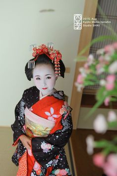 A young girl dressed as a junior maiko at a maiko photography experience.
