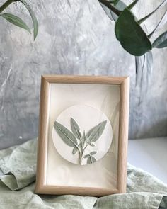 """Wooden frame botanical bas relief farmhouse wall decor by DinaArtDecor. Painted round plate """"Sage"""" wall kitchen decor. Green art tile scandinavian decor. This painted green round panel in the frame is perfect if your kitchen, porch or grill house is decorated in a rustic style"""