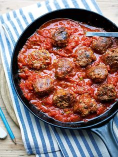 An easy beef meatball recipe served in a rich tomato sauce.