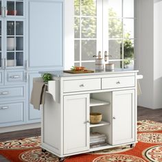 Add storage space and charm to your kitchen with this wheeled kitchen island. The stylish white finish along silver handles and pulls make this cart an adorable addition to the cottage, contemporary or beach decor schemes. This modern kitchen island cart features ample storage for all your cooking needs with shelves, drawers, a condiment rack and towel rack.