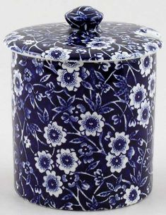Burleigh Calico Jam or Preserve Pot; Imperial: 3 ins diameter, 4.25 ins overall height Metric: 8 cm diameter, 11 cm overall height  Dark blue Calico, made in England by Burgess and Leigh. Brand new and first quality, dishwasher and microwave safe. Blue printed backstamp Calico Burleigh Staffordshire England. There is a cut out in the lid for a spoon.  	£23.95 US$36