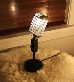 Recycled from a real deejay mic, this industrial microphone lamp gives off a warm, antique glowt.