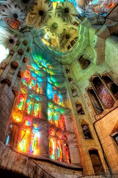Sun shining through beautiful stained glass windows in Sagrada Familia - {Roman Catholic church in Barcelona, Spain}