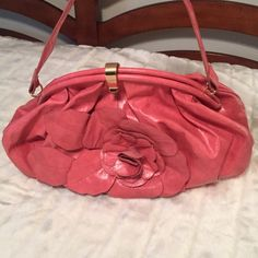 Pink Jessica Simposon Flower Bag Adorable pink flower handbag by Jessica Simpson! It has only been used once and in excellent condition. Snap closure, interior zipper pocket, 2 cellphone pockets. Matching heart key chain is included.   Reasonable offers are always considered Smoke and pet free home No PayPalNo Trades Jessica Simpson Bags Shoulder Bags