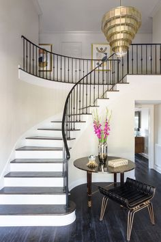 White painted risers, deep wood treads on this curved stairway design. Painted Staircases, Curved Staircase, Painted Stairs, Stair Railing, Staircase Design, White Stair Risers, Railings, Foyers, Beautiful Stairs