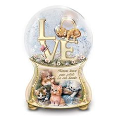 "Limited-edition Heirloom Porcelain® glitter globe celebrates love of kittens with Jürgen Scholz kitten art. Plays ""Always In My Heart."""