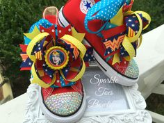 { SPARKLE TOES } WHERE EVERY PRINCESS DESERVES A LITTLE SPARKLE IN HER STEP!  ♥ Imagine the look on your little ones face when she opens these remarkably sparkly shoes fit for a princess! They are fabulous for birthdays, baby showers, christmas presents, or with halloween costumes! Adorable with leggings, tutus, and pettis! ♥ Wonder Woman inspired Converse shoes. Shoes are red Converse and come embellished with crystals and ribbon laces. Bows are attached to french clips for extra security…