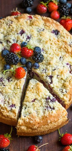 EASY Berry Crumb Cake Recipe with a crunchy topping, juicy layer of mixed berries and a soft, airy cake. There's a SECRET ingredient that makes it super fluffy!! One of our FAVORITE easy cake recipes!   natashaskitchen.com #easycake #crumbcake #cakerecipes #berrycake #cakerecipes #recipes #cake #crumbcake #dessert #berryrecipes #blueberrycrumbcake #strawberrycake