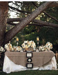 Sweetheart table with burlap cover and cute sign. Very rustic!