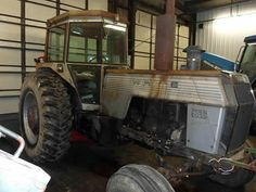 White 2-150 tractor salvaged for used parts. This unit is available at All States Ag Parts in Downing, WI. Call 877-530-1010 parts. Unit ID#: EQ-23797. The photo depicts the equipment in the condition it arrived at our salvage yard. Parts shown may or may not still be available. http://www.TractorPartsASAP.com