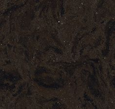 Wellington from Cambria's Waterstone Collection. A churning brew of black and brown packs an iron-like punch in Wellington, named for this southwest England industrial town. An impressive, bold statement not for the faint of heart. #Cambria #CambriaQuartz #Quartz