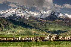 https://flic.kr/p/cz4BEA | Kyrgyz Cemetery | Most cemeteries in Kyrgyzstan feature photogenic shrine-like structures.  This one had a nice mountainous backdrop with freshly snowed on peaks.  Taken along the road between Tash Rabat and At Bashy, Naryn province.