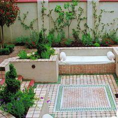 Outdoor tiled conversation area. Tile rug patio.