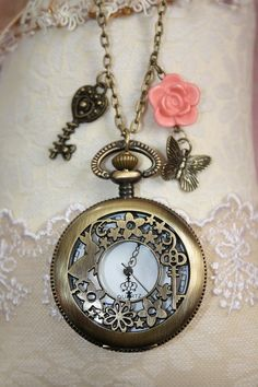 http://www.etsy.com/listing/92335898/secret-garden-pocketwatch-necklace