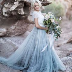 This ice blue tulle skirt separate makes us swoon! This modern alternative to a traditional wedding gown has us giddy with excitement. This look would work perfectly for a winter wedding inspiration. #weddinginspiration
